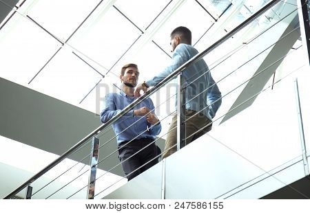Bottom View. Two Businessmen In Casual Wear Discussing At Office During Business Meeting