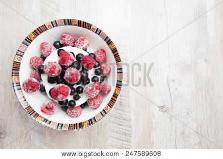 Tasty And Delicious Ice Cream With Berries On Table Currant And Raspberry