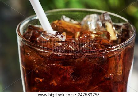 Close-up View Of A Glass Of Iced Soda On The Table In Restuarant