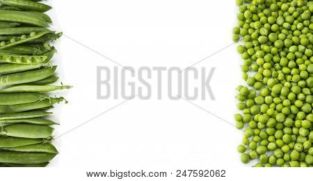 Green Peas On A White Background. Green Peas At Border Of Image With Copy Space For Text. Fresh Gree