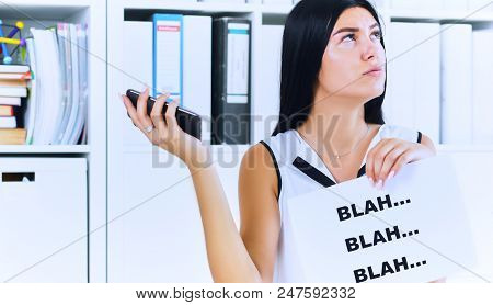 Effective communication concept. Young businesswoman in the process of useless conversation with the client or boss. poster