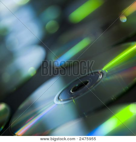 Group Of Compact Discs On Table