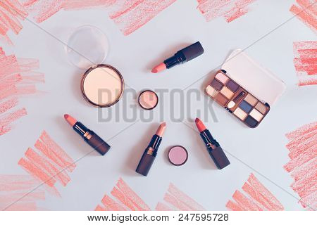 Set Of Colorful Makeup Cosmetics On Blue Background