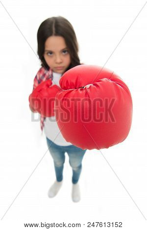Feministic upbringing. Every girl should know how defend herself. Girl seriously training boxing gloves. Child concentrated face with sport gloves practice fighting skills isolated white. Girls power. poster