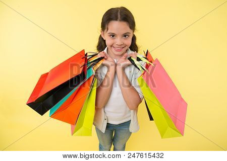 Fashion Expert. Child Cute Shopping Expert Helps Carry Packages During Shopping. Little Shop Expert.
