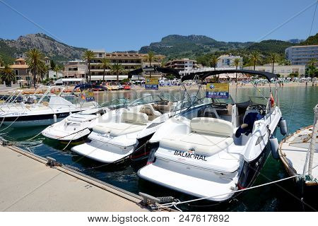 Mallorca, Spain - June 2: The Marina And Tourists Enjoiying Their Vacation In Port De Soller On June