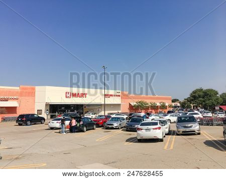 H Mart Supermarket Customer Loading Groceries Into Car Trunk