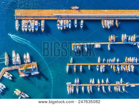 Aerial View Of Beautiful Boats At Sunset In Summer. Minimalistic Landscape With Boats And Sea In Mar