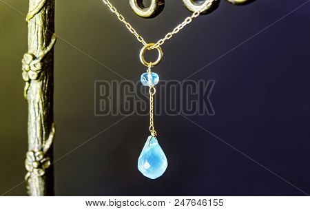 Golden Necklace With Apatite With Green Chalcedony With Blue Topaz On Black Background.close Up.