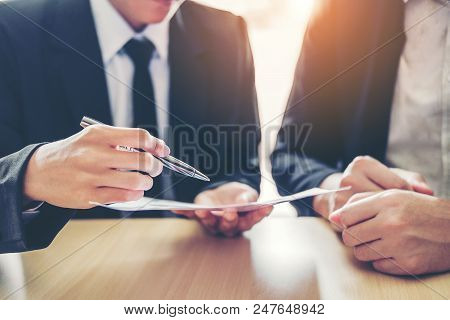 Business People Meeting Negotiating A Contract Between Two Colleagues