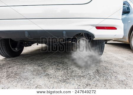 Combustion Fumes Coming Out Of Car Exhaust Pipe, Air Pollution Concept.