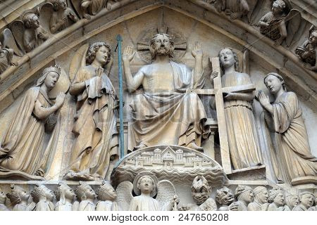 PARIS, FRANCE - JANUARY 04: Christ in Majesty, Portal of the Last Judgment, Notre Dame Cathedral, Paris, UNESCO World Heritage Site in Paris, France on January 04, 2018.