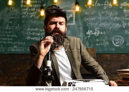 Man With Beard On Thinking Face. Bearded Man With Retro Typewriter And Microscope. Scientist Make Re