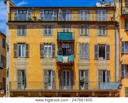 Facade Of Traditional Mediterranean House With Llusion Paint Work In The Streets Old Town Of Nice, F