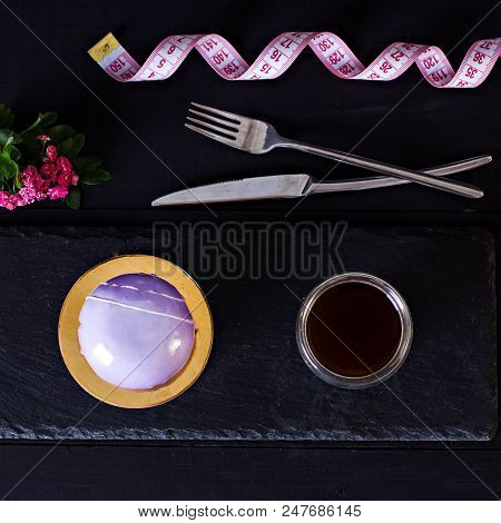 cake with mirror glaze. Small mousse cakes with mirror glaze. Violet cake. Purple berry cake with blackberry, blueberry, bilberry, meringue and violet mirror glaze. Modern european pastry. poster