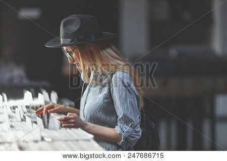 Young girl browsing records in a music store
