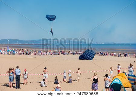 Swansea, United Kingdom -  June 30, 2018: Tigers Parachute Display Team Landing On The Beach At The
