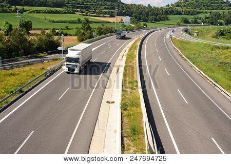 view of the ,Eix Transversal de Catalunya ,motorway near Montfalco Murallat, LLeida province, Catalonia, Spain poster