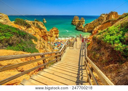 Wooden Walkway To Scenic Praia Do Camilo In Lagos Coast, Algarve, Portugal. The Long Stairs To Clear