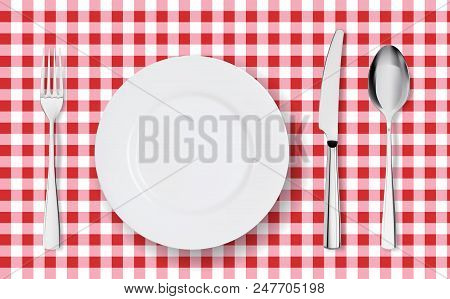 Top View Of Table Place Setting For Dinner On Red Tablecloth With Empty Plate Glasses And Cutlery. K