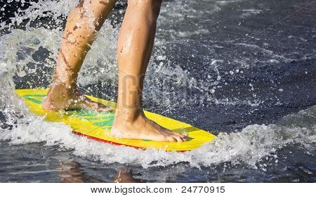 Man Riding On A Board On Water