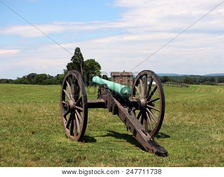 Civil War Cannon With House In Background
