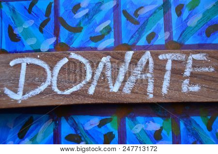 Word Donate On An  Abstract Blue Background
