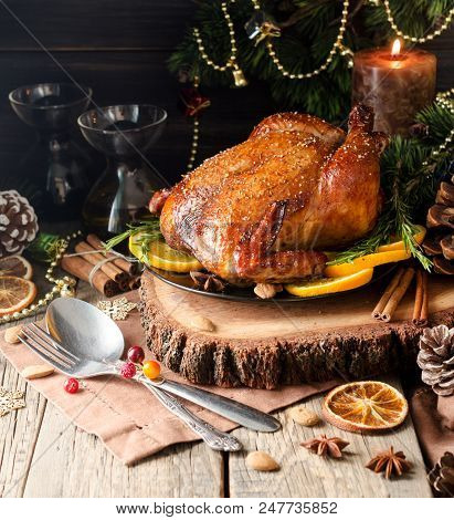 Roast Chicken Or Turkey For Christmas Dinner And New Year With Mulled Wine And Christmas Decorations