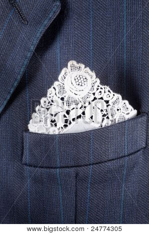 Formal suit breast pocket with a lace white handkerchief