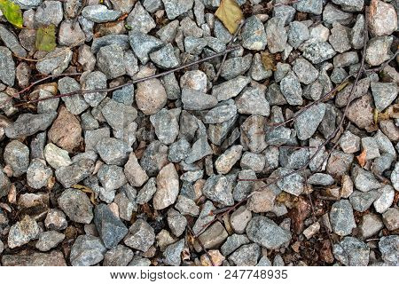 small stones and rubble on the road poster