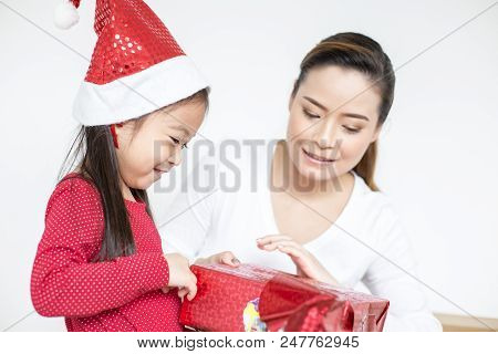 Attractive Asian Girl Received A Present At Brithday With Her Family. Kid Holding Gift With Attracti