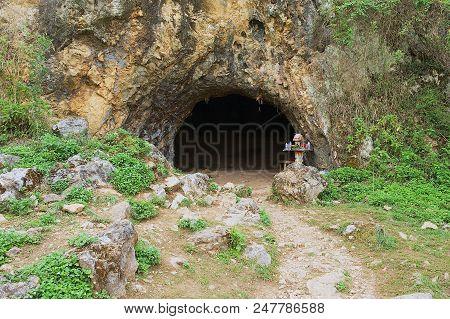 Phonsavan, Laos - April 19, 2012: Entrance To The Ancient Crematorium Cave At The Plain Of Jars (sit