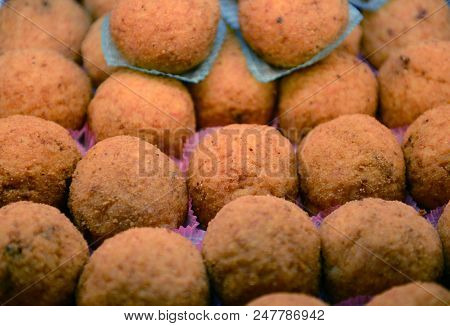 Baked Rice Balls, Filled With Cheese Or Other Sauce, Originally From Sicily.