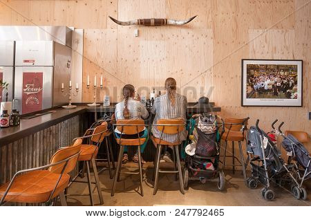 Stockholm, Sweden - Jun 16, 2018: Family Of Modern Vikings With Baby Carriages Having Lunch At Fast-