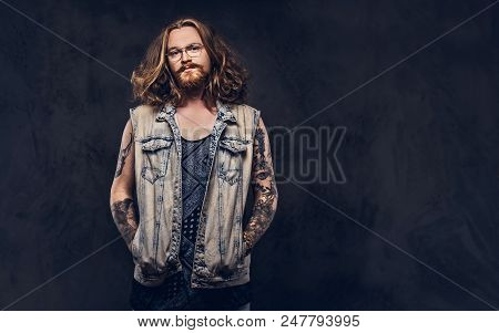 Redhead Hipster Male With Long Luxuriant Hair And Full Beard Dressed In Casual Clothes Posing With H