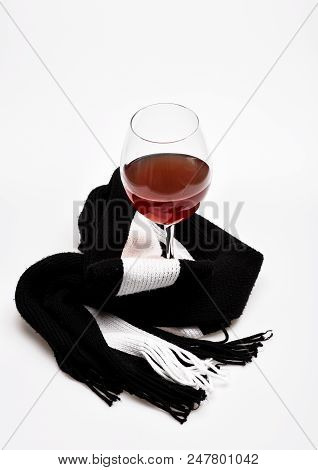 Glass With Wine Wrapped With Black Scarf, Isolated On White Background. Wineglass With Alcohol Drink
