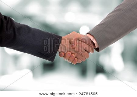 Closeup picture of businesspeople shaking hands, making an agreement.