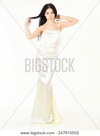Elegant Dress Concept. Girl On Pensive Face In Graceful Dress. Woman In Elegant White Dress With Lon
