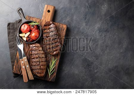 Closeup Ready To Eat Steak Top Blade Beef Breeds Of Black Angus With Grill Tomato, Garlic And On A W
