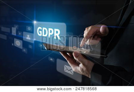 Businessman Holding Tablet And Sign Text Gdpr (data Protection Regulation). Cyber Security.