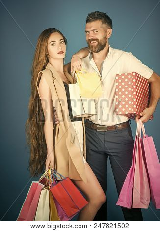 Couple Of Shopaholics. Girl And Bearded Man Hold Present Pack, Cyber Monday. Shopping And Sale. Blac
