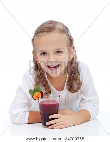 Healthy happy girl laughing with fresh beetroot and carrot juice