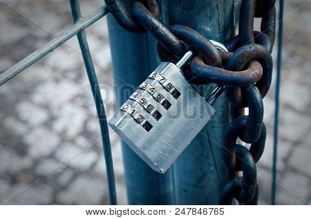 Padlock On A Construction Site With A Rusty Chain To Illustrate Encryption With A Numerical Code In