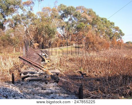Remains Of A Burned Down Foot Bridge After Bush Fire In An Suburban Area Of Knox City In Melbourne E