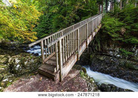 Wooden Miners Bridge Over The Afon Lledr, In Betws-y-coed, Gwynedd, North Wales, Uk