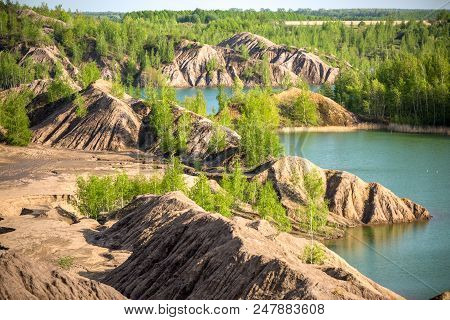 Picture Of Hilly Terrain With Green Trees And River On Summer Day