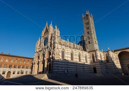 Siena Cathedral (Santa Maria Assunta) 1220-1370 with clear blue sky. Toscana (Tuscany), Italy, Europe poster