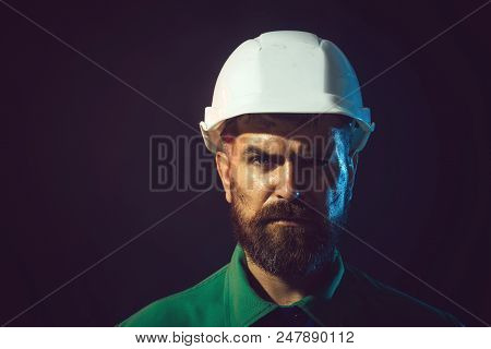 Portrait Bearded Man With Protect Helmet Wearing. Hard Work. Close Up Engineers Working. Architect,