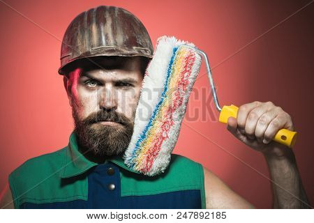 Painter Man. Room Painting Job. Handsome Bearded Worker With Paint Roller. Professional Painter, Dec