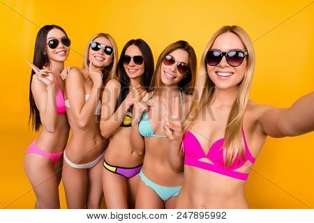 Five Young Cute Ladies In Sunglasses Are Posing For A Selfie Photo Shot, Blond Is Taking. They Are A